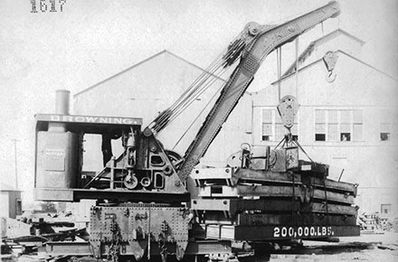 A wrecking crane lifts a test load.