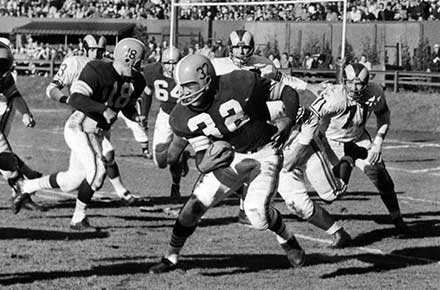 Jim Brown runs for most yards in a single game, 1957