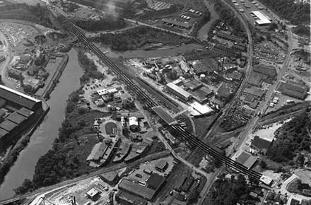 Aerial view of Harvard Denison Bridge with deck installation, 1976