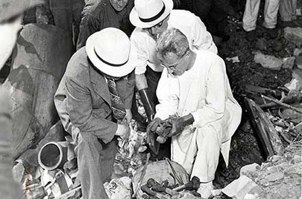 Inspecting remains of torso murderer victim, 1938