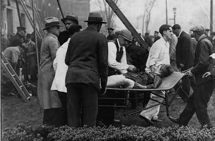 Assisting a victim of the Cleveland Clinic fire, 1929