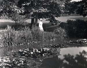Elisabeth Severance Allen Prentiss standing next to a pond at Glenallen