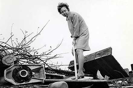 Betty Klaric cleaning up park, 1969.