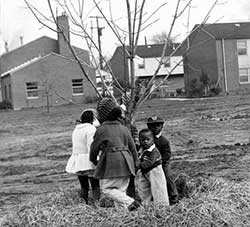 Children planting a tree at Garden Valley