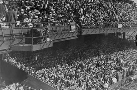Spectators in stands at ball game, League Park, 1937